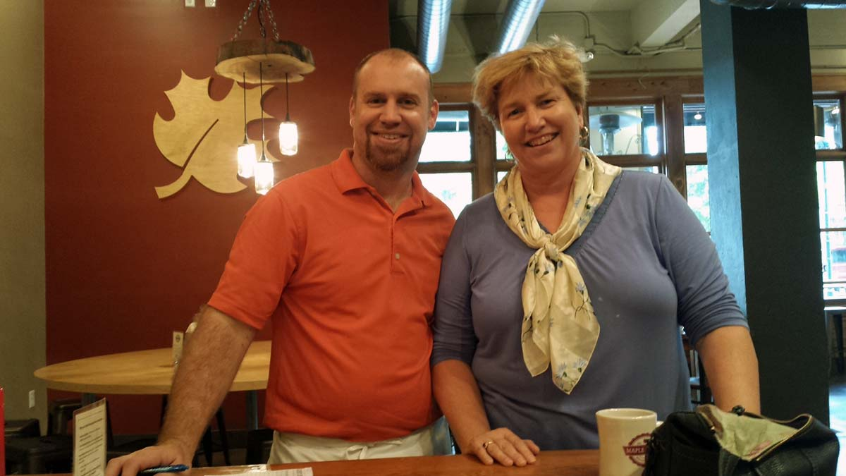 CSO executive director, Molly Sasse and owner Zeke discuss breakfast and coffee options for meetings.