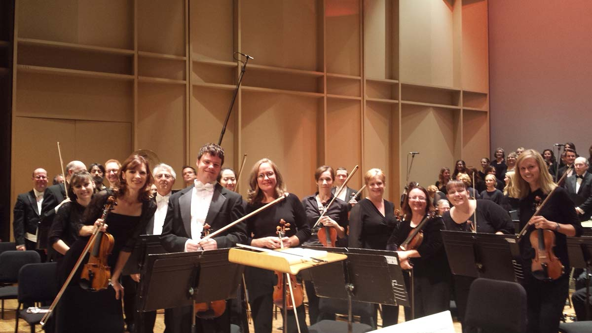 Group photo of the Chattanooga Symphony & Opera violin sections.