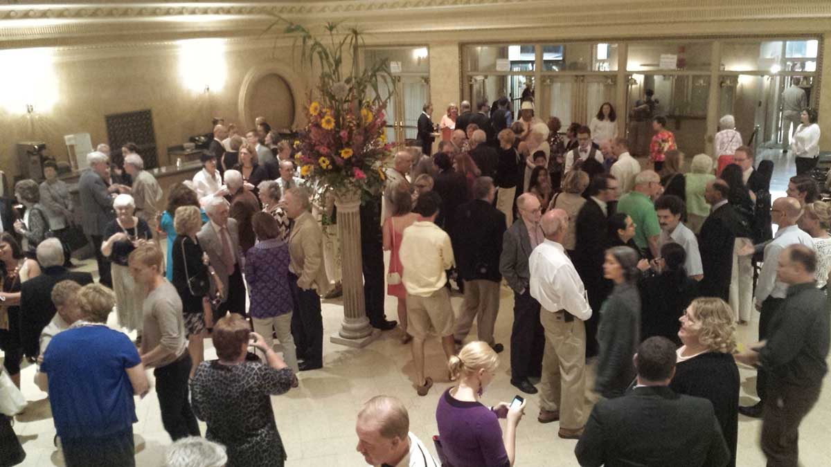 Audience enjoying the post-concert champagne and conversation